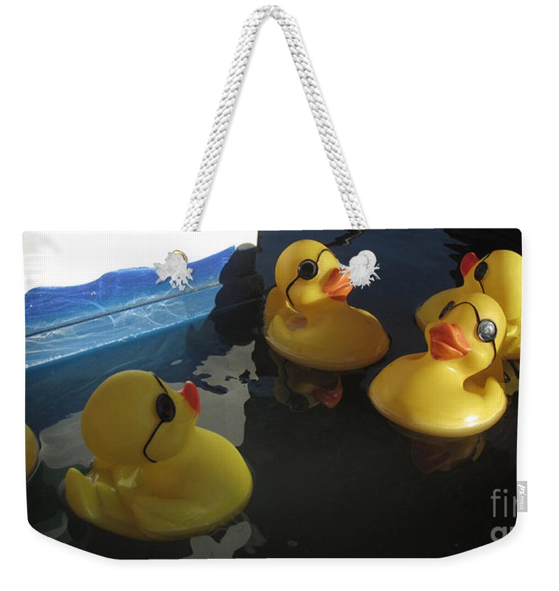 Ducks Weekender Tote Bag featuring the photograph Yellow Rubber Duckies by Donna Brown