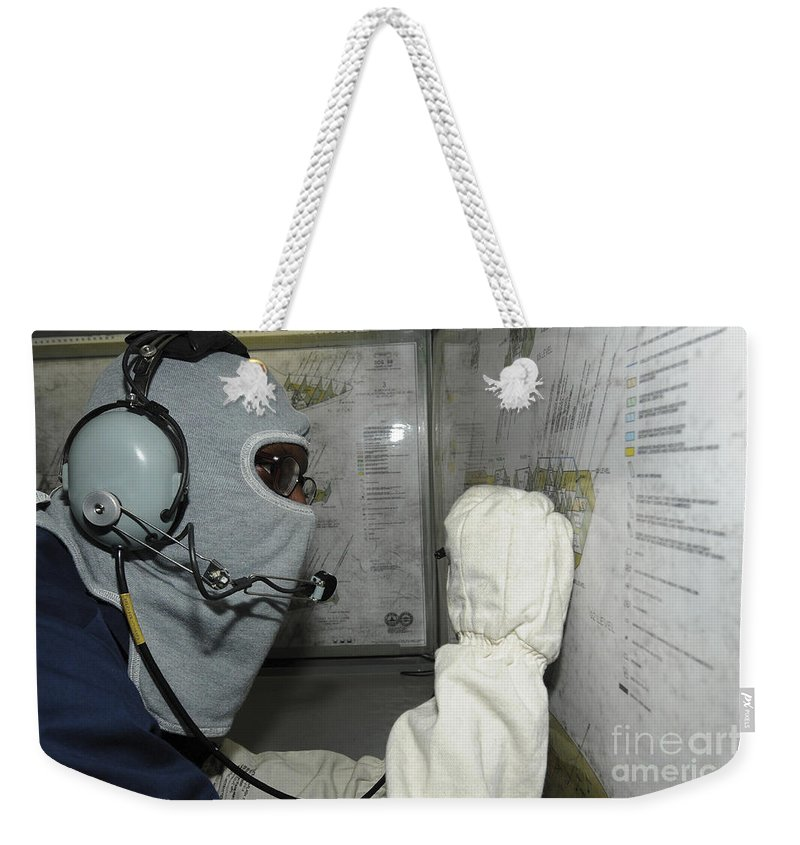 Military Weekender Tote Bag featuring the photograph Yeoman Plots Simulated Damage by Stocktrek Images