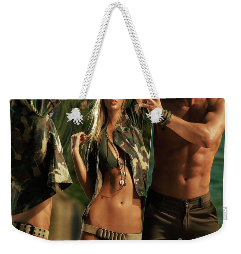 Couple Weekender Tote Bag featuring the photograph Young Man Holding A Mirror For A Woman by Oleksiy Maksymenko