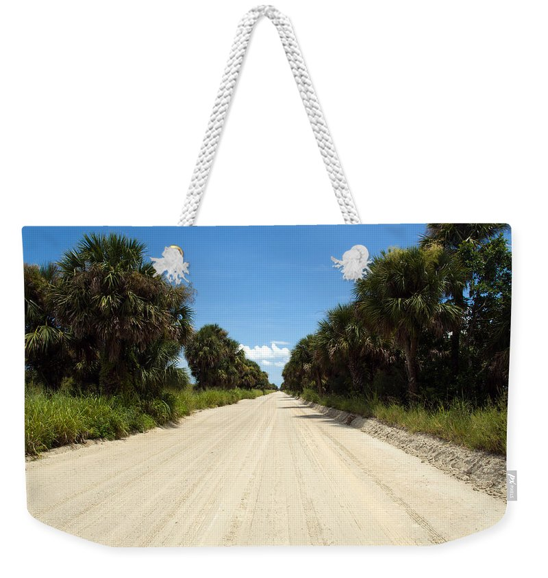 Florida; Road; Back; Backroad; Central; Dirt; Plow; Plowed; Clay; Mud; Muddy; Places; Unknown; Trave Weekender Tote Bag featuring the photograph Back Road In Central Florida. by Allan Hughes