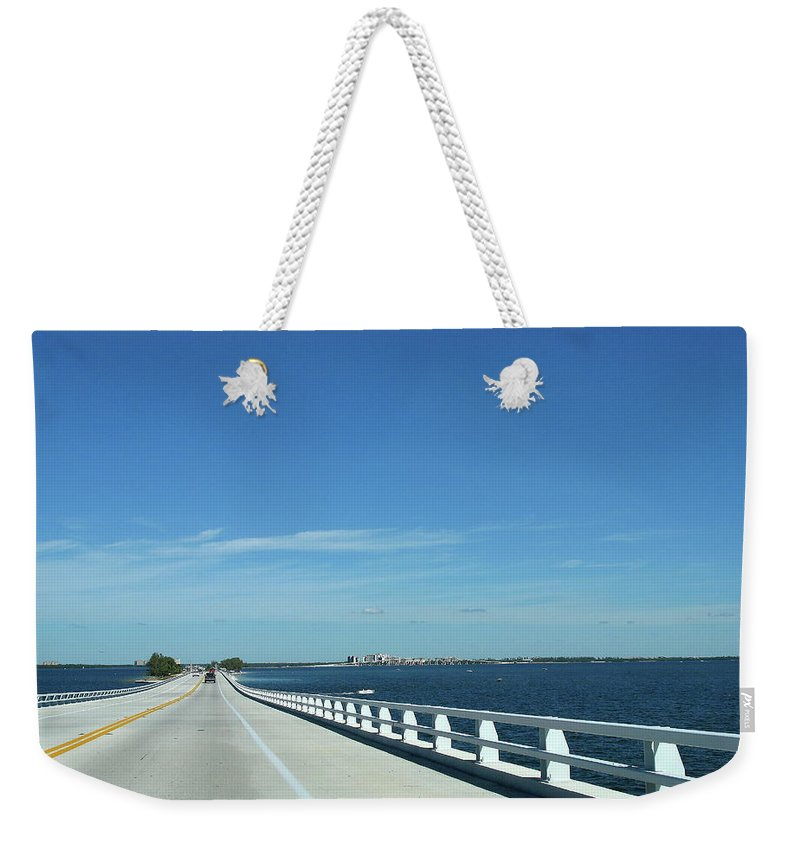 Bridge Weekender Tote Bag featuring the photograph Bridge Over The Sea by Christiane Schulze Art And Photography