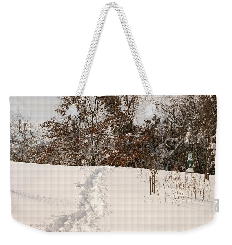 White Weekender Tote Bag featuring the photograph Christmas Snow Trail by Heidi Poulin