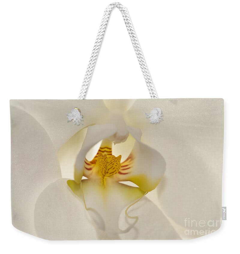 Orchid Weekender Tote Bag featuring the photograph In The Heart Of The Orchid by Sandra Bronstein