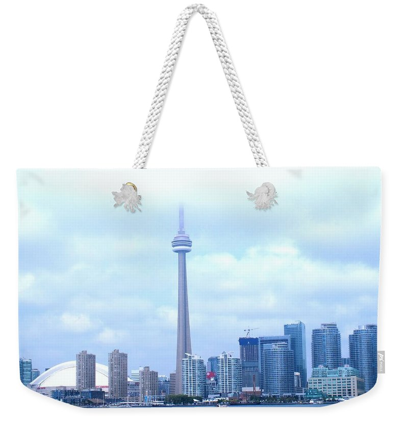 Toronto Weekender Tote Bag featuring the photograph Lost In The Clouds by Ian MacDonald