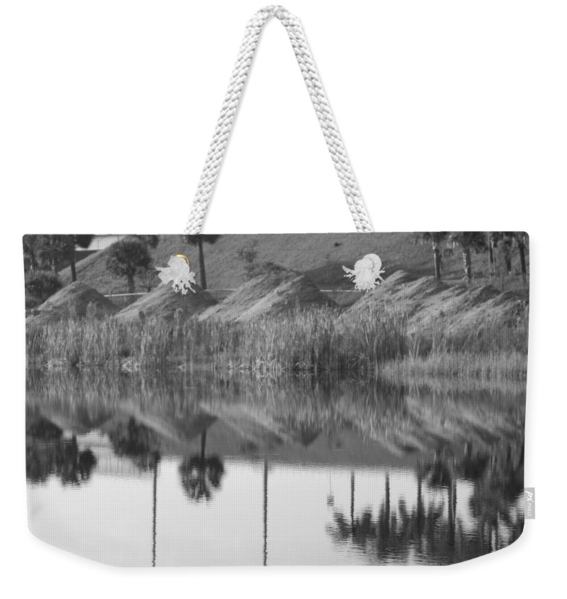 Pyrimids Weekender Tote Bag featuring the photograph Pyrimids By The Lakeside Cache by Rob Hans