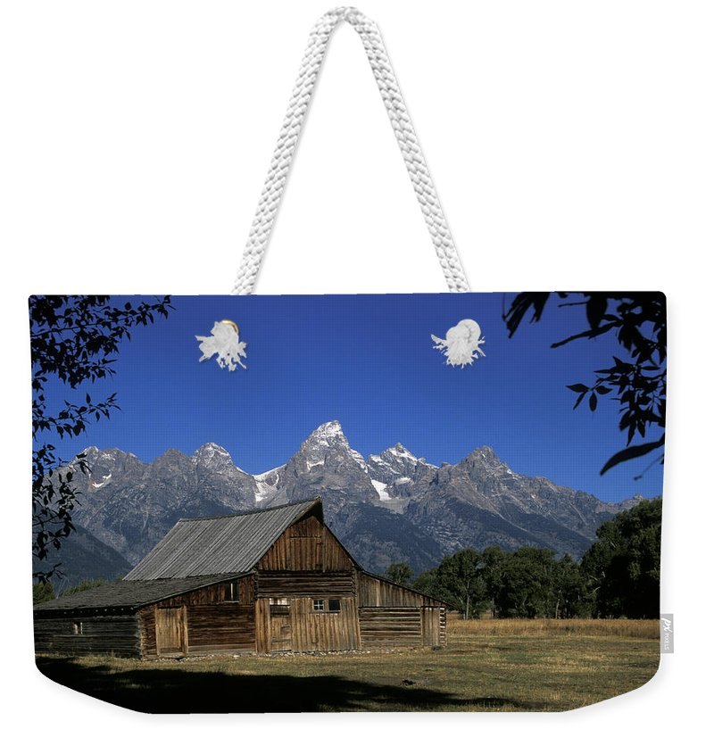 Late Snow Weekender Tote Bag featuring the photograph South Moulton Barn Grand Tetons by Gary Langley