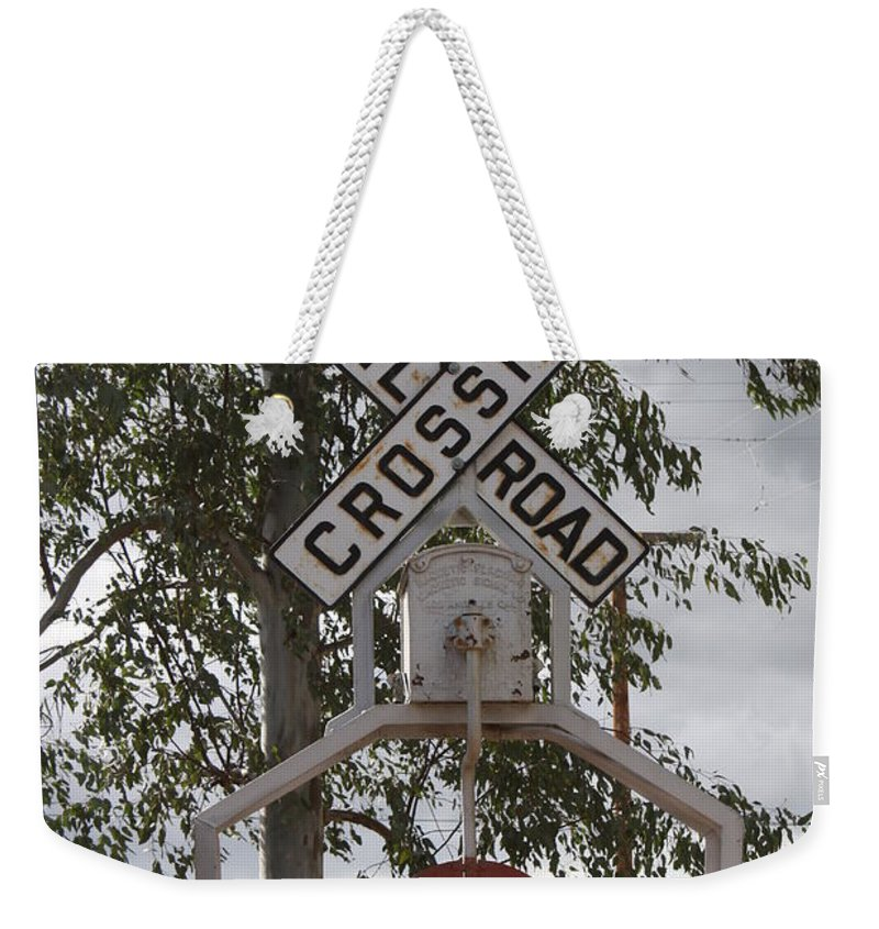 Railroad Weekender Tote Bag featuring the photograph The Cossing by Tommy Anderson