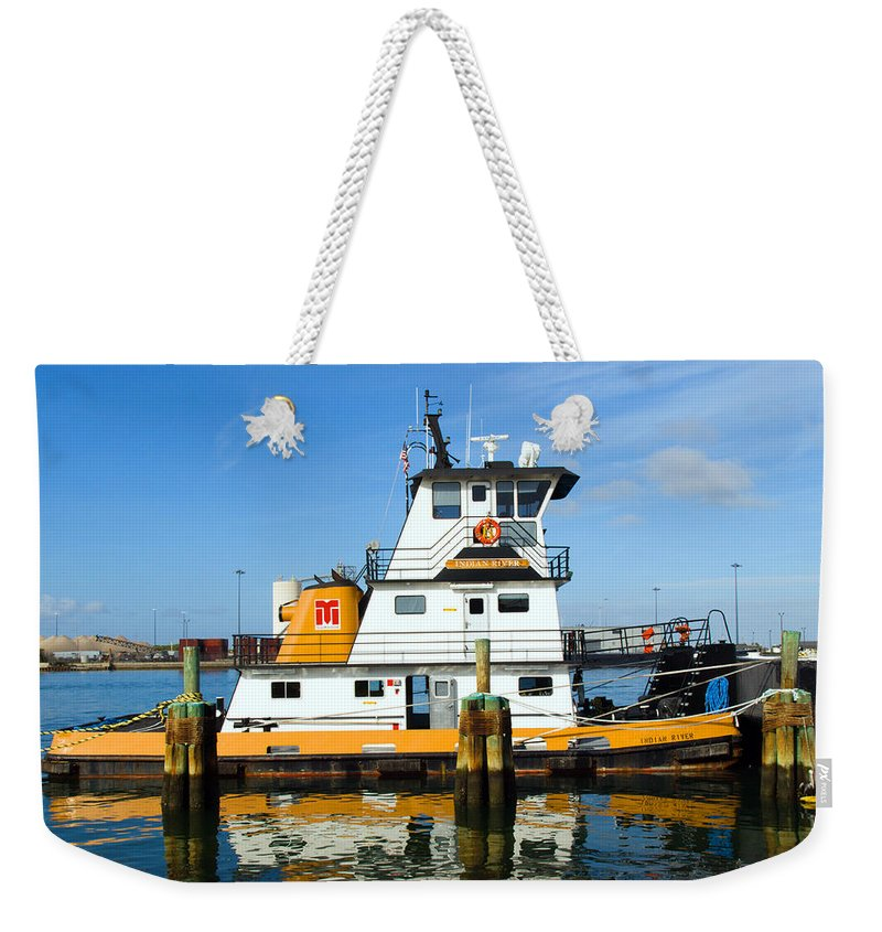 Florida; East; Space; Coast; Tug; Boat; Tugboat; Tow; Towboat; Pusher; Pushes; Push; Cargo; Fuel; Oi Weekender Tote Bag featuring the photograph  Tug Indian River Is Part Of The Scene At Port Canvaeral Florida by Allan Hughes