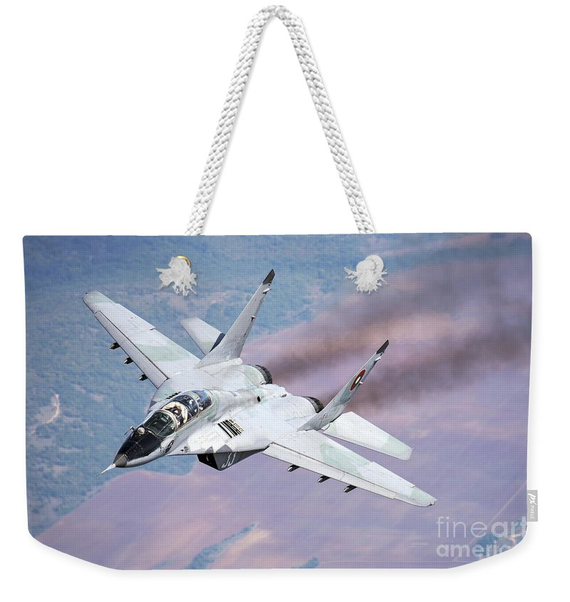 Horizontal Weekender Tote Bag featuring the photograph A Bulgarian Air Force Mig-29s by Daniele Faccioli