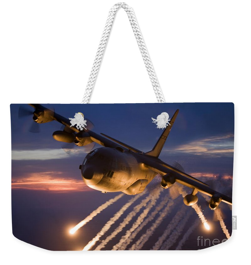 Smoke Weekender Tote Bag featuring the photograph A C-130 Hercules Releases Flares by HIGH-G Productions