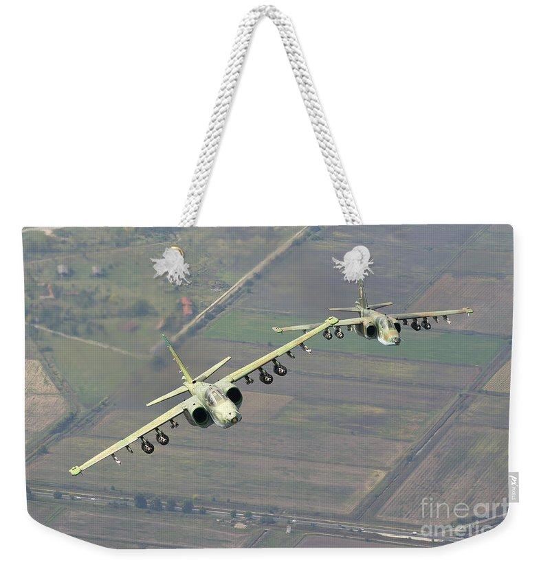 Horizontal Weekender Tote Bag featuring the photograph A Pair Of Bulgarian Air Force Sukhoi by Daniele Faccioli