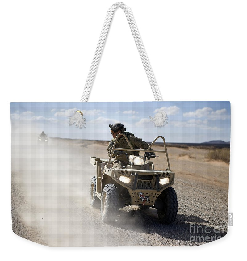 Soldier Weekender Tote Bag featuring the photograph A U.s. Soldier Performs Off-road by Stocktrek Images