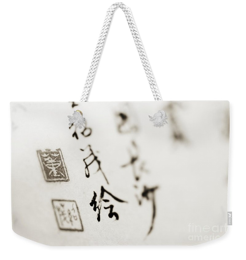 Artistic Weekender Tote Bag featuring the photograph Asian Calligraphy by Ray Laskowitz - Printscapes