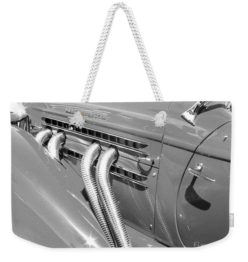 Auburn Weekender Tote Bag featuring the photograph Auburn Boattail Speedster by Neil Zimmerman