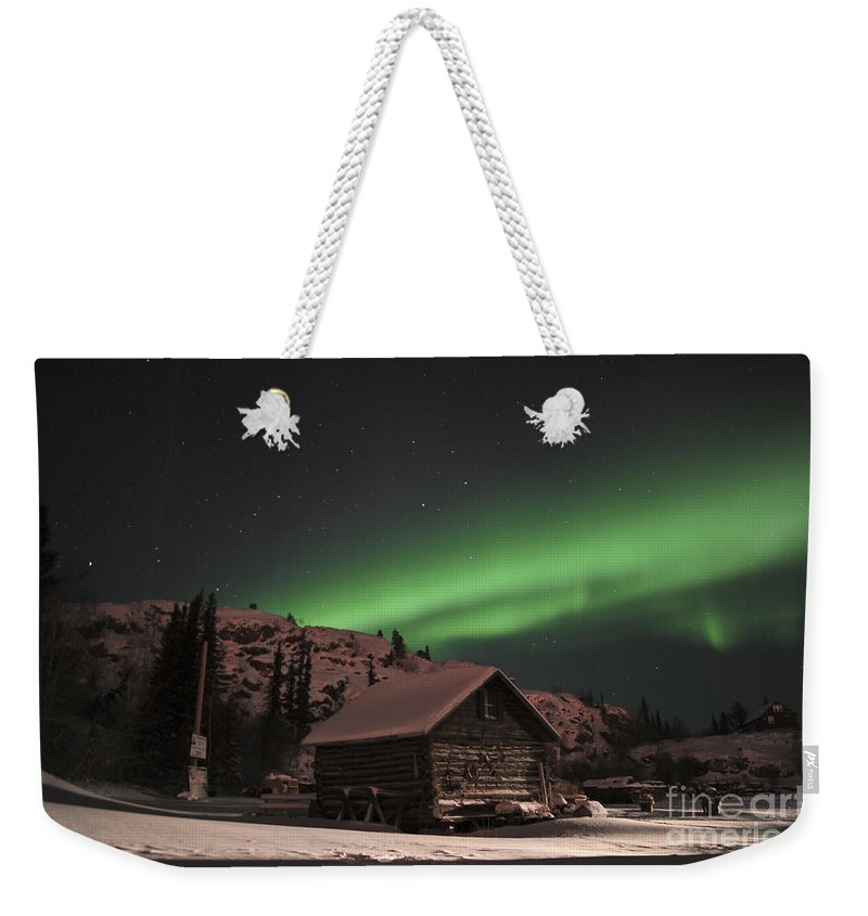 Yellowknife Weekender Tote Bag featuring the photograph Aurora Borealis Over A Cabin, Northwest by Jiri Hermann