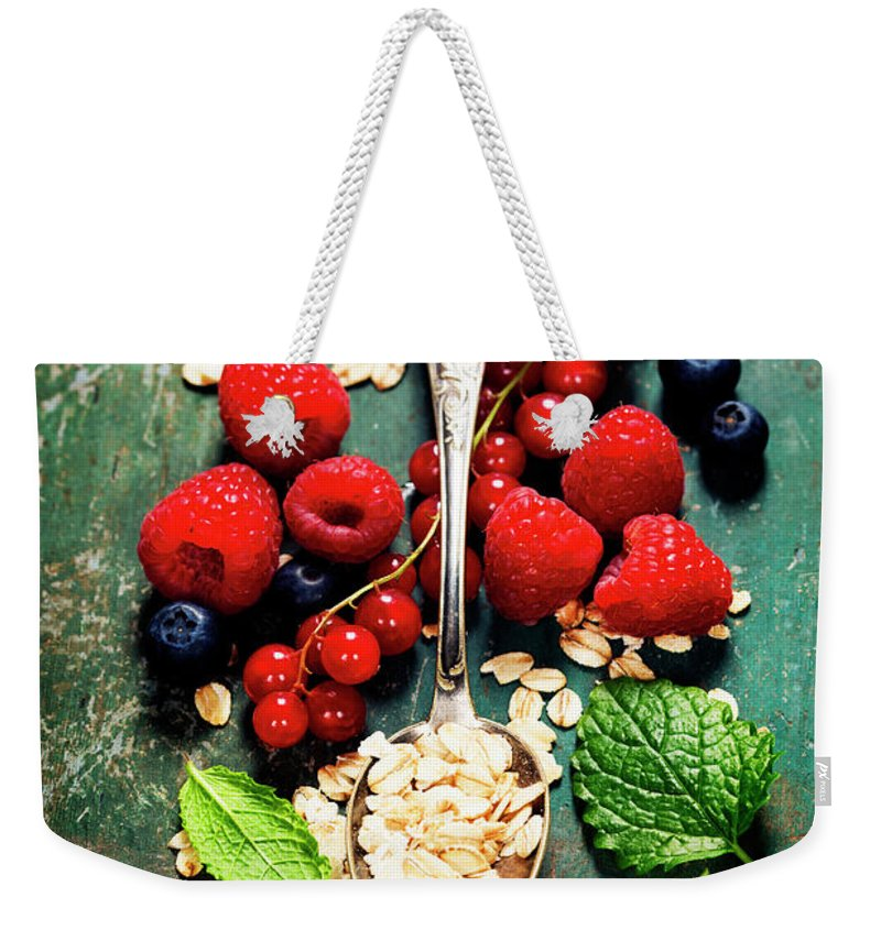 Oat Weekender Tote Bag featuring the photograph Breakfast With Oats And Berries by Natalia Klenova