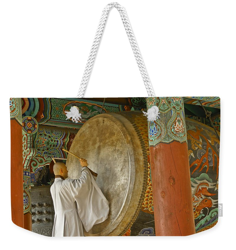 Asia Weekender Tote Bag featuring the photograph Buddhist Monk Drumming by Michele Burgess