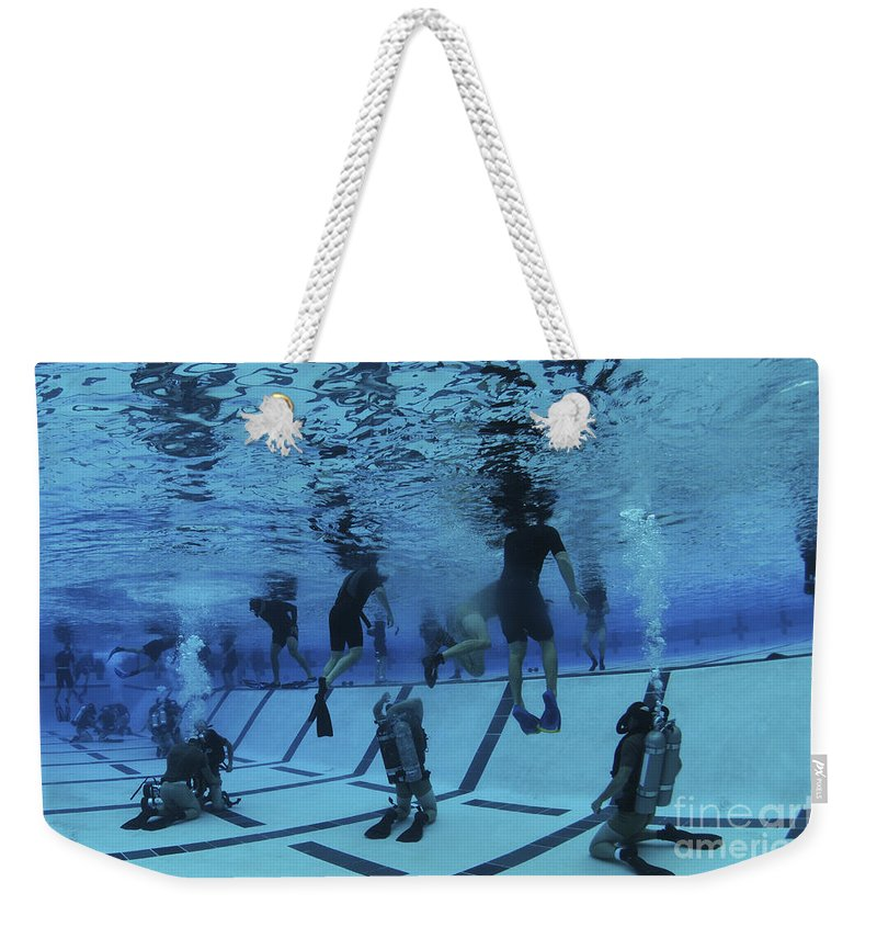 Special Operations Forces Weekender Tote Bag featuring the photograph Buds Students Participate In Underwater by Stocktrek Images