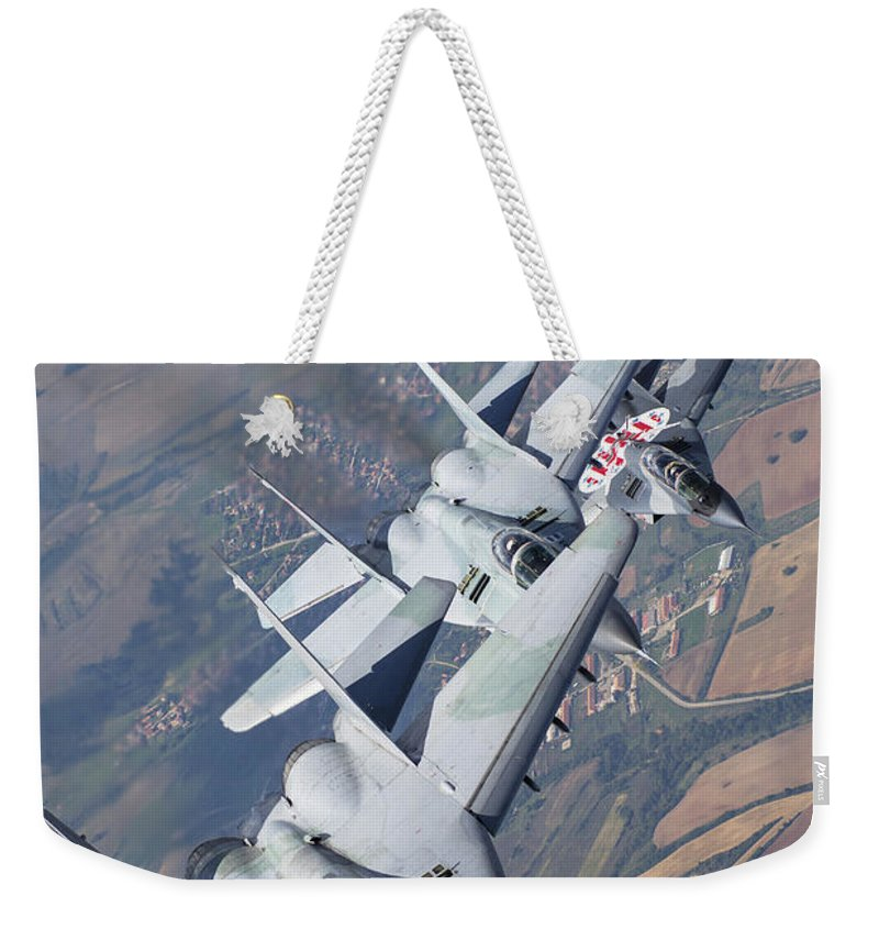 Vertical Weekender Tote Bag featuring the photograph Bulgarian And Polish Air Force Mig-29s by Daniele Faccioli