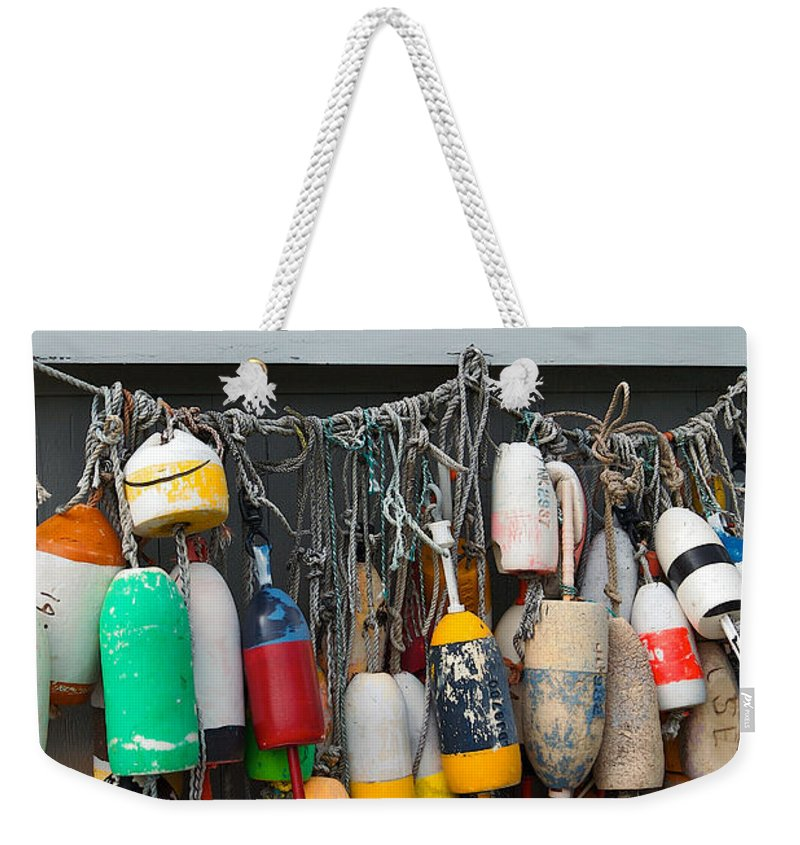 Lawrence Weekender Tote Bag featuring the photograph Buoys by Lawrence Boothby