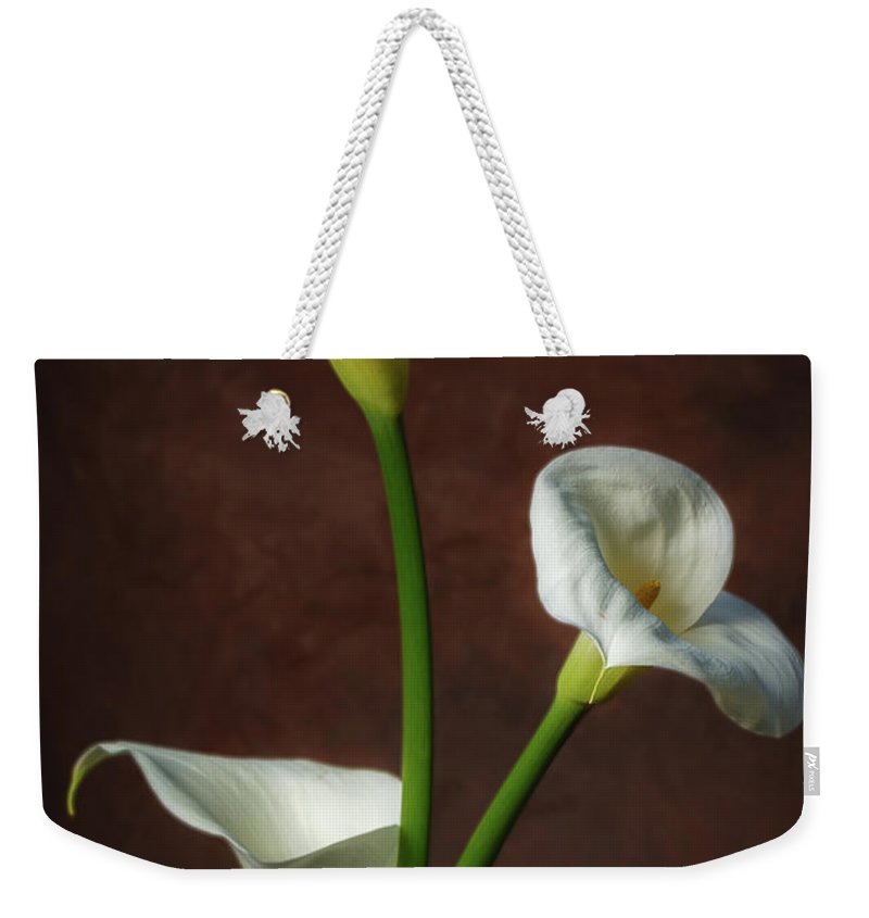 Still Life Weekender Tote Bag featuring the photograph Cala Lilies by Mike Penney