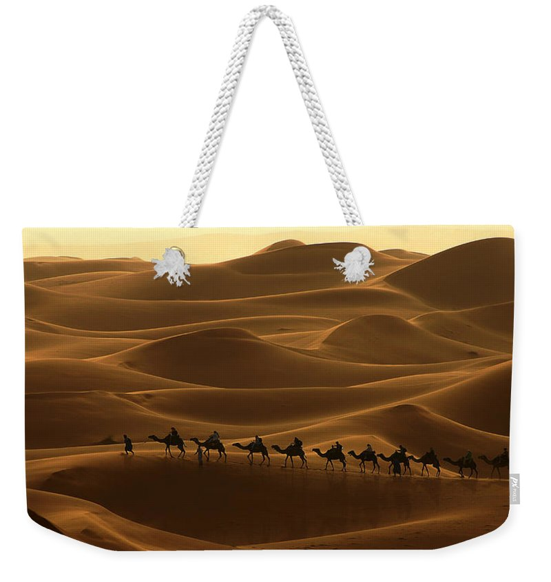 Camel Weekender Tote Bag featuring the photograph Camel Caravan In The Erg Chebbi Southern Morocco by Ralph A Ledergerber-Photography