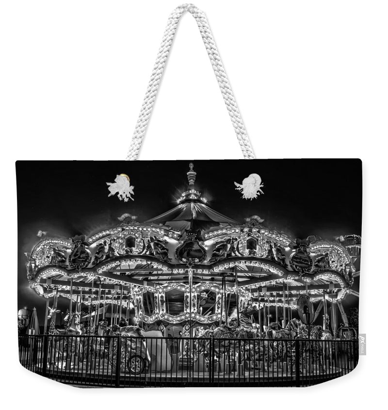 B&w Weekender Tote Bag featuring the photograph Carousel At Night by Alex Grichenko