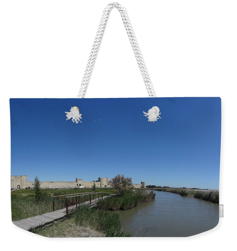 Weekender Tote Bag featuring the photograph Cattle Of Saint Louis In Aigues Morte by Andres Chauffour