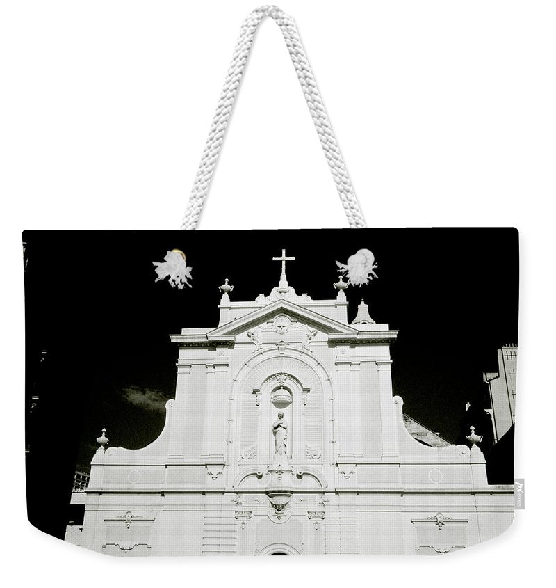 Marseille Weekender Tote Bag featuring the photograph Chiaroscuro Christianity by Shaun Higson