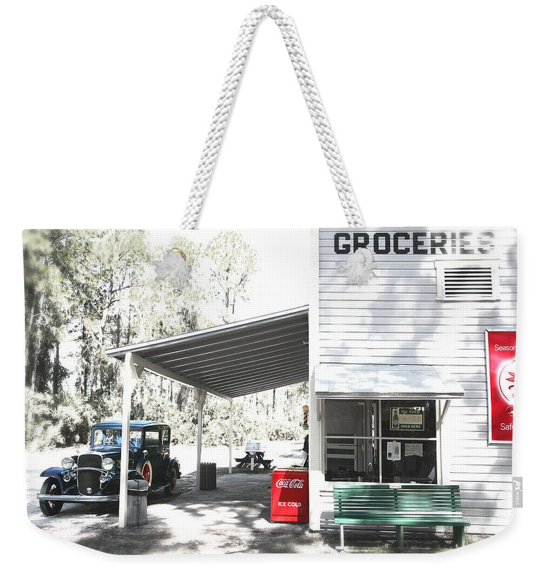 Chevy Weekender Tote Bag featuring the photograph Classic Chevrolet Automobile Parked Outside The Store by Mal Bray