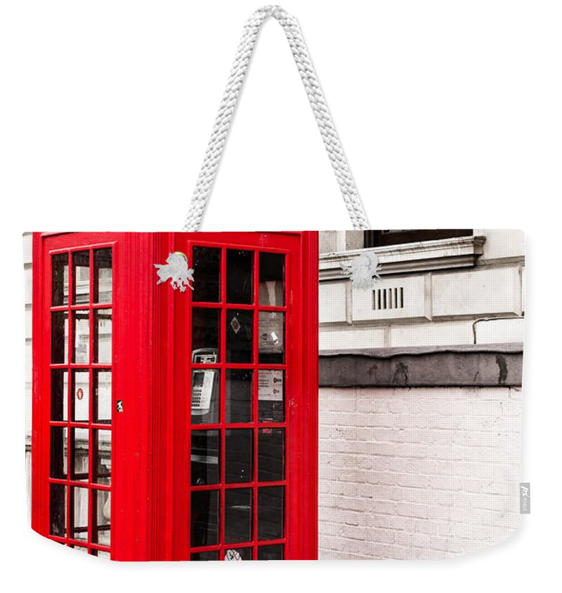 Antique Weekender Tote Bag featuring the photograph Classic Red London Telephone Box by John Williams