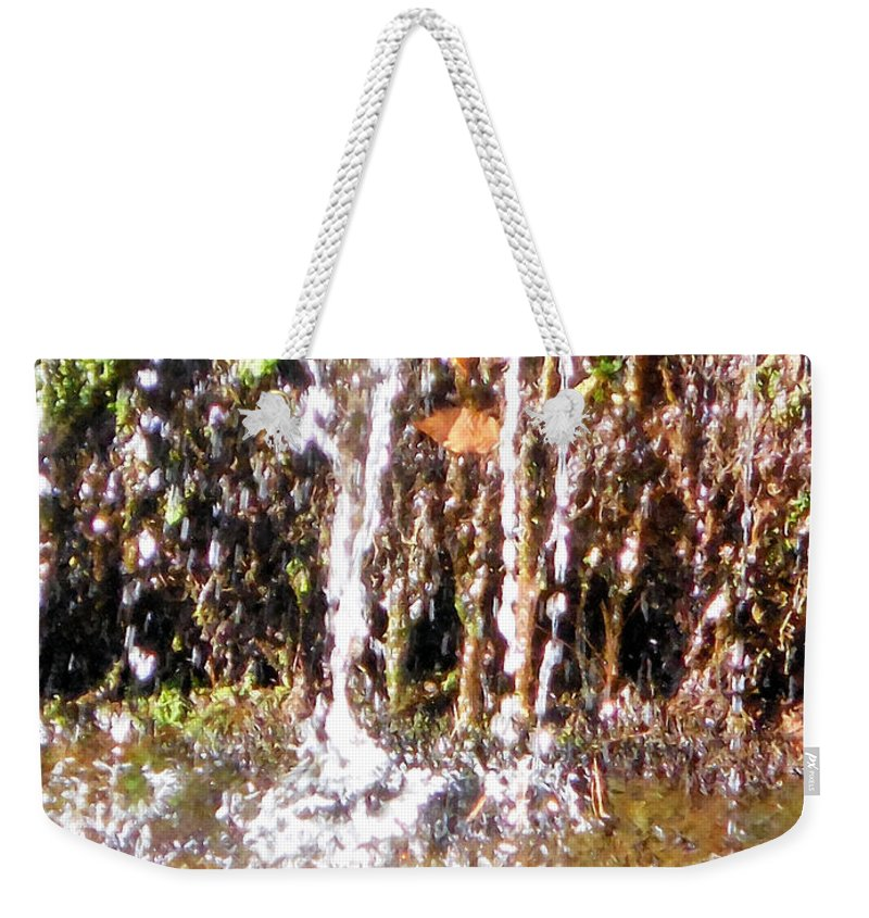 Alone Weekender Tote Bag featuring the painting Close Up Of Waterfall Flowing Over Rocks by Jeelan Clark