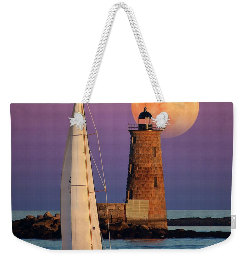 Moon Lunar Full Moon Sea Sailboat Boat Sunset Sunrise Dawn Dusk Astronomy Astronomical Water Peaceful Peace Quiet Nautical Lighthouse Light House Seashore Weekender Tote Bag featuring the photograph Convergence by Larry Landolfi