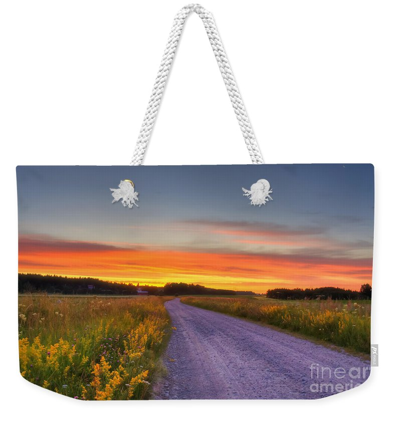 Atmosphere Weekender Tote Bag featuring the photograph Country Road by Veikko Suikkanen