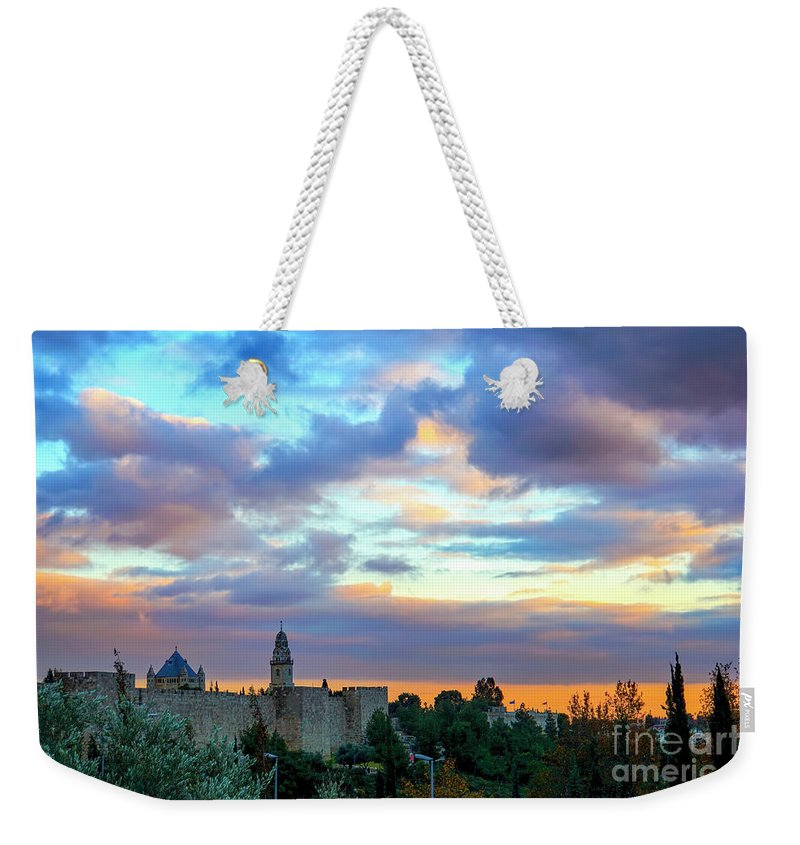 Middle East Weekender Tote Bag featuring the photograph David Tower At Sunset by Vladi Alon
