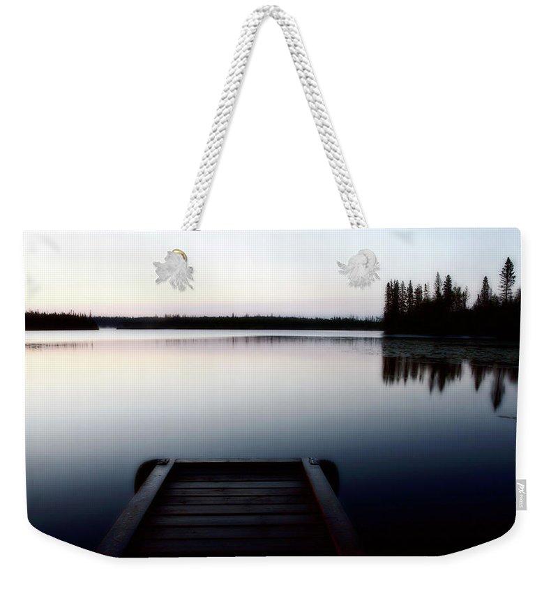 Reflections Weekender Tote Bag featuring the digital art Dawn At Lynx Lake In Northern Saskatchewan by Mark Duffy