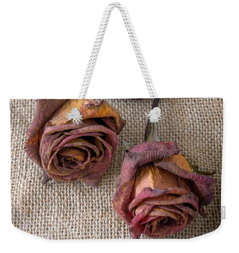 Melancholy Weekender Tote Bag featuring the photograph Dead Roses by Carlos Caetano