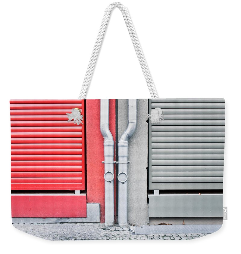 Abstract Weekender Tote Bag featuring the photograph Drain Pipes by Tom Gowanlock