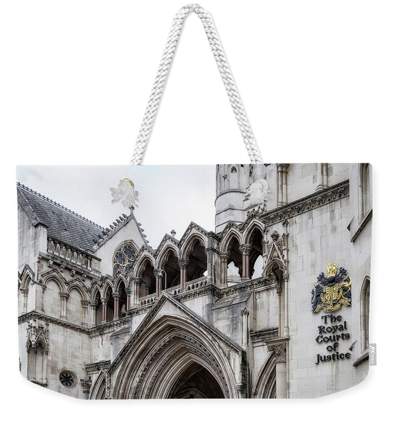 London Weekender Tote Bag featuring the photograph Entrance To Royal Courts Of Justice London by Shirley Mitchell
