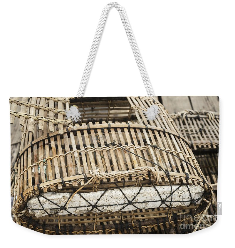 Asia Weekender Tote Bag featuring the photograph Fishermen Bamboo Crab Cages At Kep Market Cambodia by Jacek Malipan