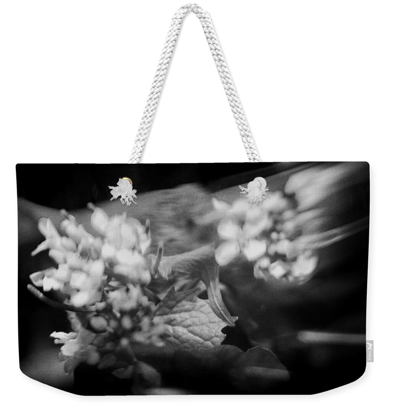 Blacj And White Weekender Tote Bag featuring the photograph flowers in Motion by Scott Wyatt