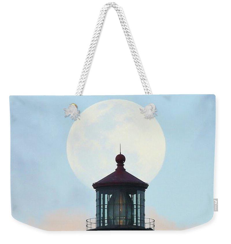 Photosbymch Weekender Tote Bag featuring the photograph Full Moon Over Makapu'u Light by M C Hood