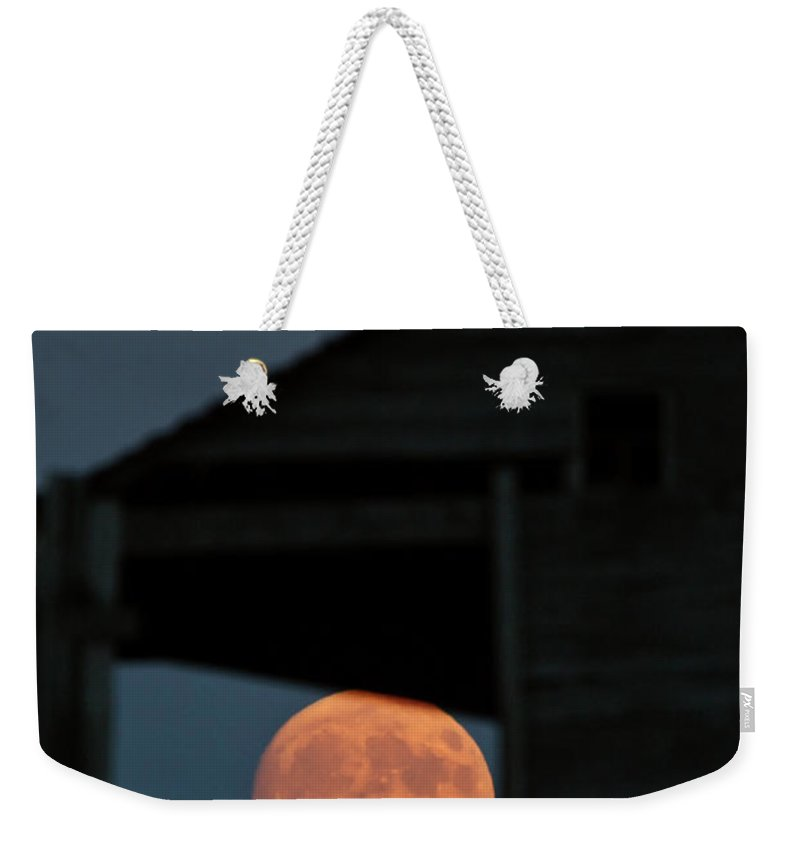 Full Moon Weekender Tote Bag featuring the digital art Full Moon Seen Through Old Building Window by Mark Duffy