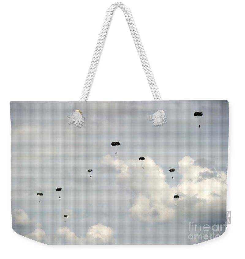 Soldier Weekender Tote Bag featuring the photograph Halo Jumpers Descend To The Ground by Stocktrek Images