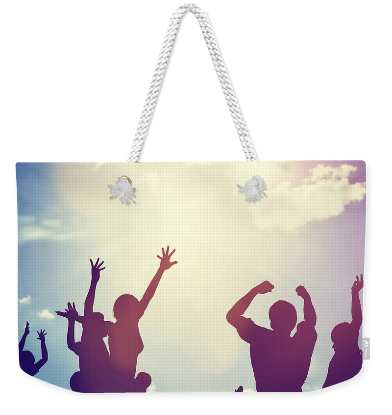 Happy Weekender Tote Bag featuring the photograph Happy Friends Family Jumping Together Having Fun by Michal Bednarek