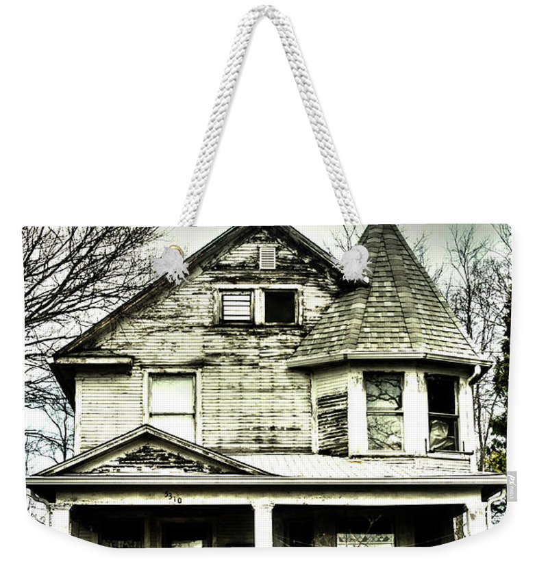 Weekender Tote Bag featuring the photograph Haunting by Melissa Newcomb