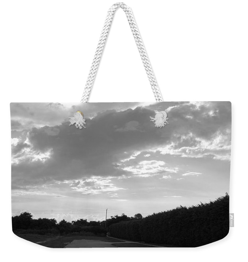 Black And White Weekender Tote Bag featuring the photograph Homestead Sky by Rob Hans