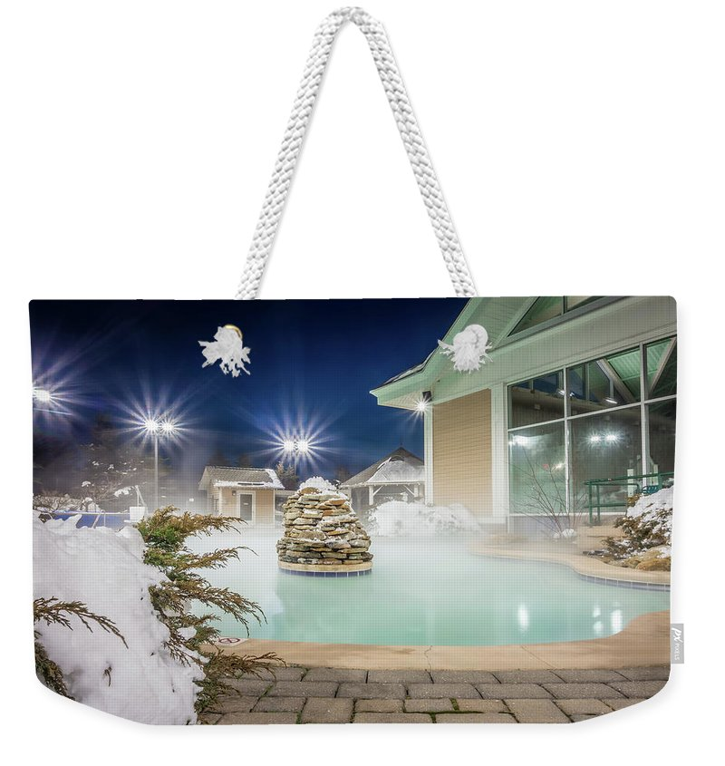 Outdoor Weekender Tote Bag featuring the photograph Hot Tubs And Ingound Heated Pool At A Mountain Village In Winter by Alex Grichenko
