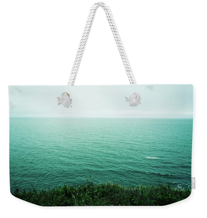 Canada Weekender Tote Bag featuring the photograph Infinite Sea by Olivia StClaire