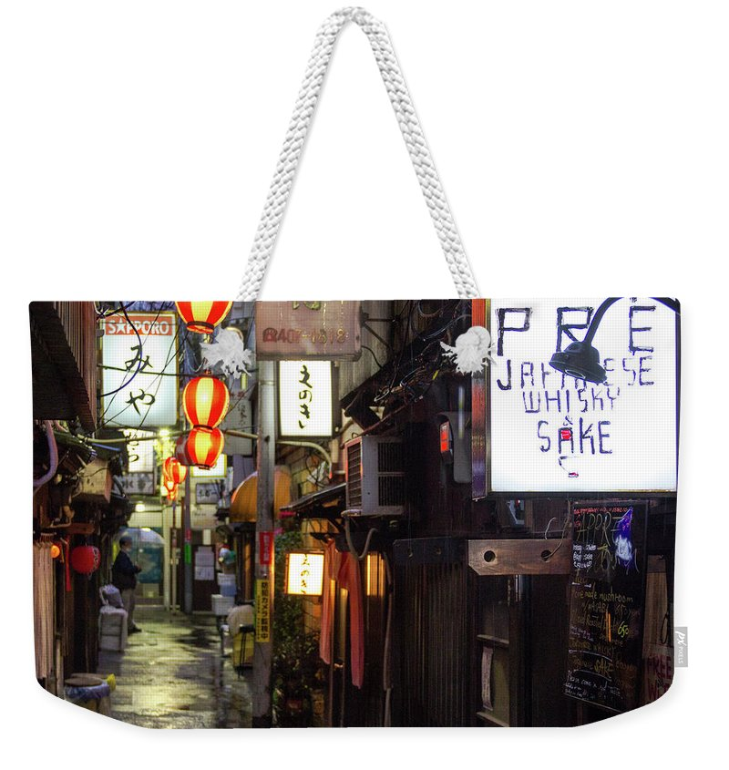 Asia Weekender Tote Bag featuring the photograph Izakaya by Peteris Vaivars